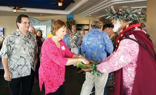 Steven Dascoulias and state Sen. Roz Baker prepare to congratulate the newly inducted Maui Rotary presidents with cleansing of the hands offered by Pastor Laki Ka'ahumanu.