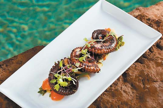 kiawe-smoked local octopus with pohole fern sprouts, Kula tomatoes and blue ginger. RYAN SIPHERS photo