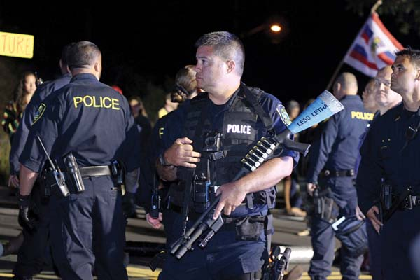 Police did not show up in riot gear as protest organizers requested, but one protester said she thought the riot weaponry was unnecessary and raised tensions. The Maui News / COLLEEN UECHI photo