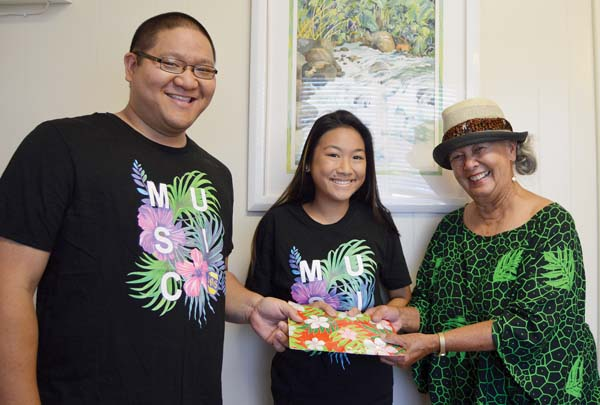 St. Anthony Band Director Everett Yamashita (from left) and student band President Krislyn Martinez accept a $10,000 donation from kumu hula Gordean Bailey. Her halau designated proceeds from a silent auction to the St. Anthony School music program in honor of Bailey's music kumu, or teacher, and St. Anthony alum Haywood Kahauanu Lake.