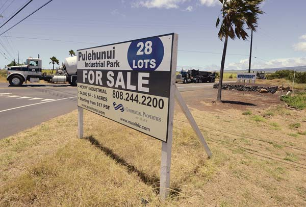 A sign advertising lots for sale in the Pulehunui commercial business park in Central Maui is shown last month. -- The Maui News / MATTHEW THAYER photo
