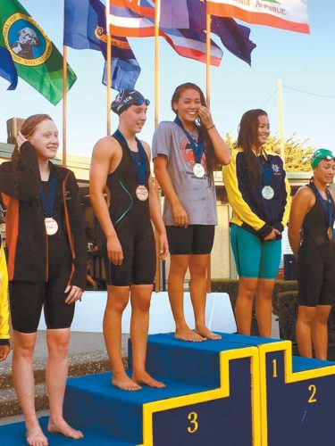Jasmine O'Brien of Hawaii Swim Club smiles as she stands atop the podium after receiving her gold medal for winning the 400 freestyle at the USA Swimming Futures Championships on Saturday in Santa Clara, Calif. REID YAMAMOTO photo