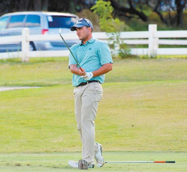Nainoa Calip watches his shot on the 17th hole Sunday. The Maui News / ROBERT COLLIAS photo