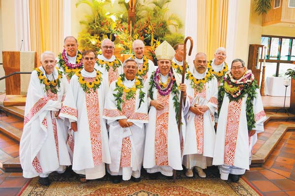 "Graduates of the St. Patrick's Seminary Class of 1977 gather around Bishop Larry Silva (fourth in front row) for a group photo Sunday. The group has been hosted by St. Theresa pastor and Maui Vicar Forane the Rev. Msgr. Terrence Watanabe (front row, far right). Other members of the seminary class include the Rev. Denny Knurek (front row, left to right), the Rev. Larry Hendel, Bishop Randolph Calvo, Silva, the Rev. Robert ""Doc"" Charm and Watanabe. In the rear row are Hawaii Vicar General the Rev. Msgr. Gary Secor (left to right), the Rev. Fred Riccio, the Rev. Tom Reilly, the Rev. Steven Brown and the Rev. James Fredericks. The Maui News / BRIAN PERRY photo"