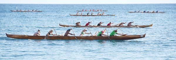 Kahana Canoe Club's mixed open crew charges to a win in the last event of the Hawaiian Canoe Racing Association state championship regatta Saturday afternoon at Hanakao'o (Canoe) Beach Park. The Maui News / MATTHEW THAYER photo