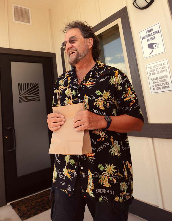 Fred Rickert holds a bag containing his dried medical cannabis flowers, the only product the Health Department approved because it has not certified a lab for manufactured cannabis products. The Maui News / MATTHEW THAYER photo