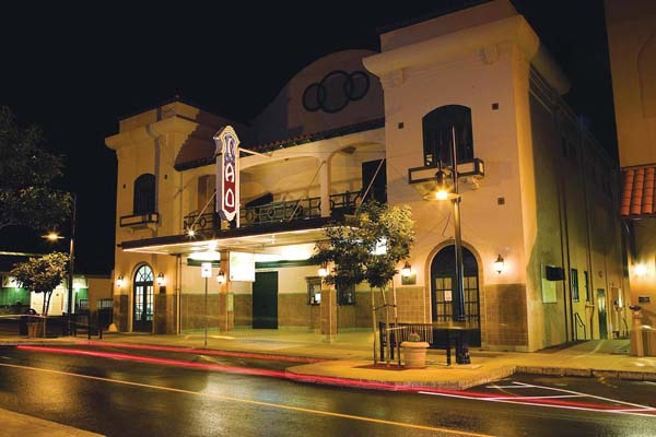 The Historic Iao Theater in Wailuku dramatically lit at night as it currently looks. Photo courtesy Maui Historical Society