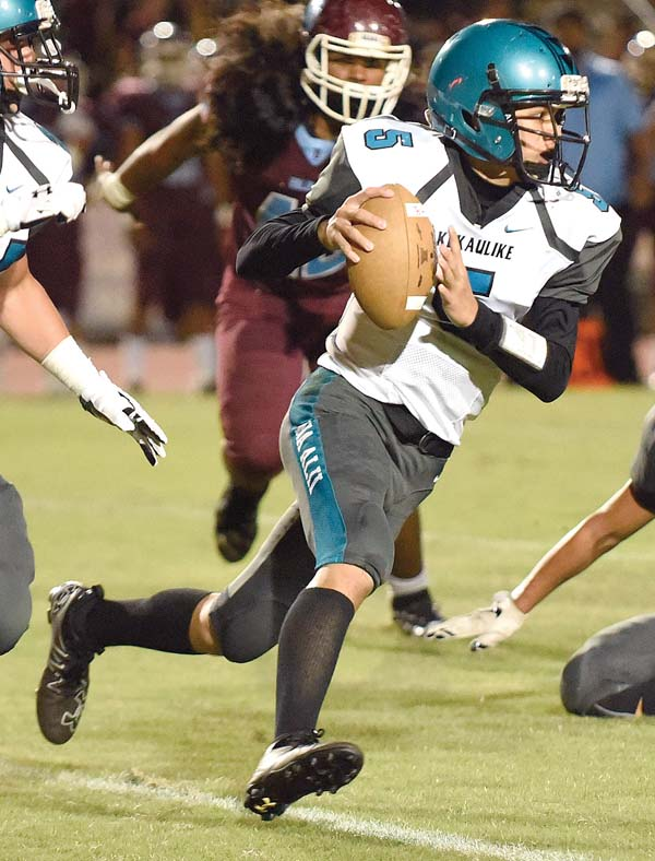 King Kekaulike quarterback Trey Hunter ranked sixth in passing and 11th in rushing last season in Maui Interscholastic League play. -- The Maui News / MATTHEW THAYER photo