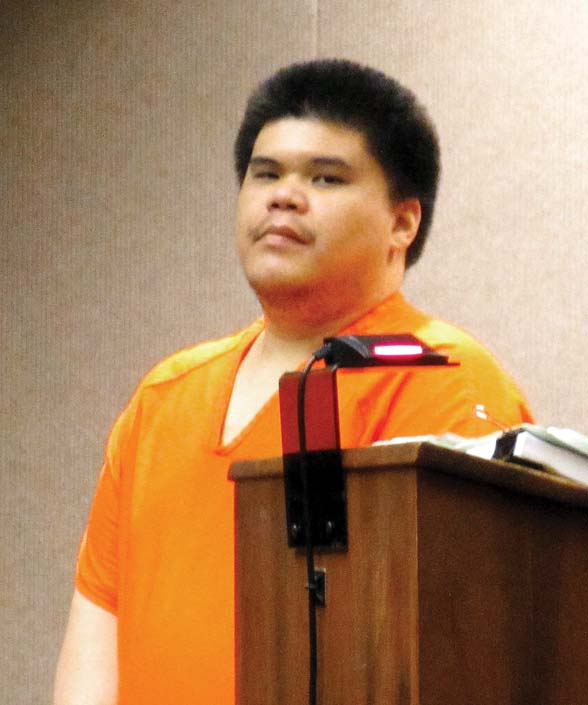 Keoni Vinuya Tomas, appearing in 2nd Circuit Court on Friday, is sentenced to life in prison with the possibility of parole for the murders of his aunt and mother. -- The Maui News / LILA FUJIMOTO photo