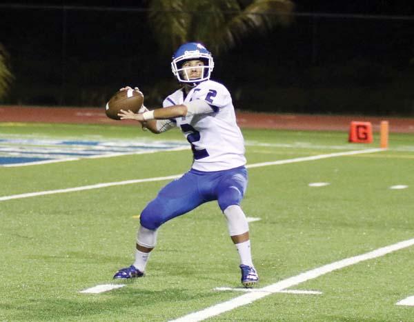 Sabers quarterback Kainalu Tancayo looks to pass. -- Hawaii Tribune-Herald / TIM WRIGHT photo