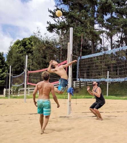 Josh Kulhavy-Sutherland spikes a ball set by Colton Cowell as Corey Spence gets ready to block during an Aloha Volleyball men's tournament match Saturday in Kula. -- SCOTTIE ZUCCO photo