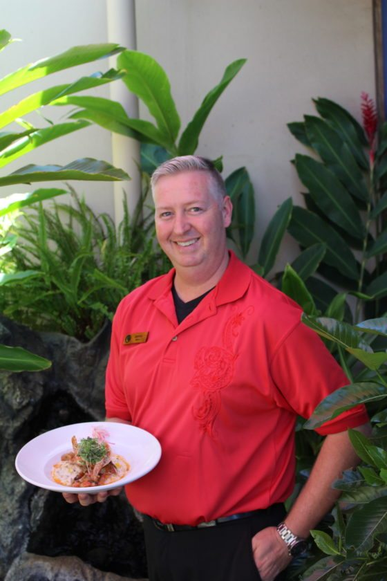 Food & Beverage Director James Morrison holds a dinner entree of hamachi and Kauai shrimp over corn-and-mushroom risotto. • The Maui News / CARLA TRACY photo