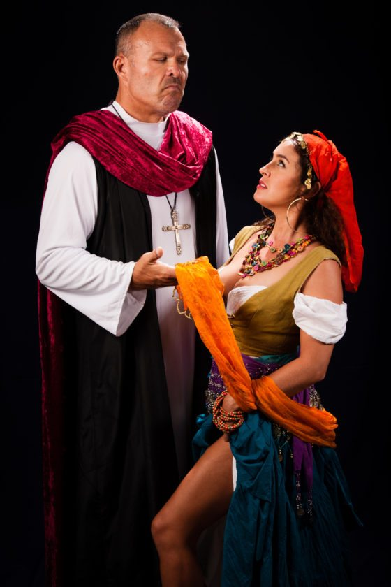 """Will Kimball (left) as Frollo lusts for Danielle Mealani Delaunay's Esmeralda in """"The Hunchback of Notre Dame The Musical."""" •Peter Swanzy photo"""