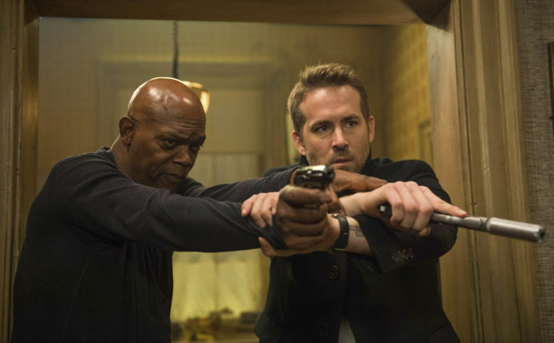 "Samuel L.Jackson (left) and Ryan Reynolds  star in ""The Hitman's Bodyguard."" • Lionsgate via AP photo"