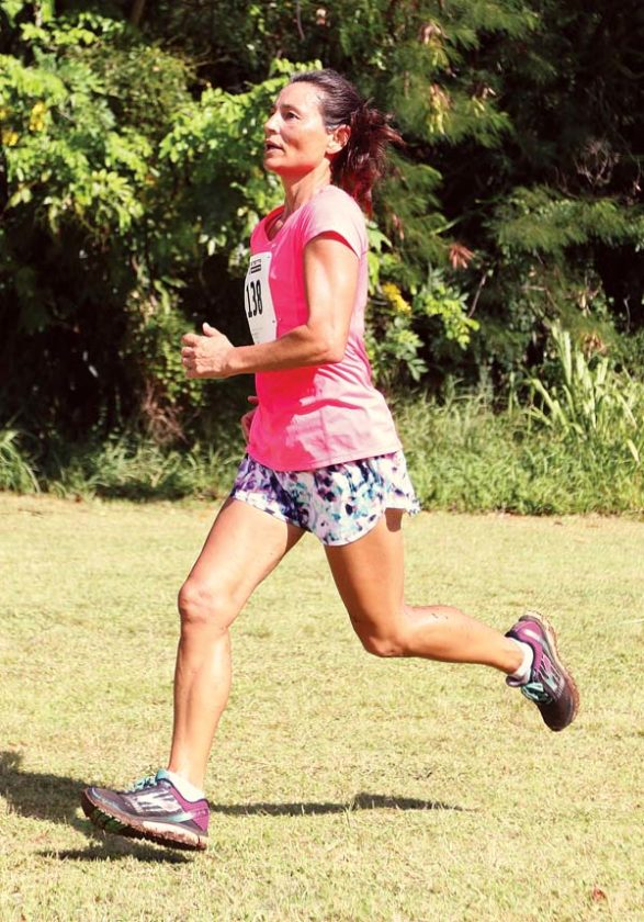 Karen Harmer, 51, of Haiku makes her way to the finish line in the Xterra Adventure Fest 5K on Saturday at D.T. Fleming Beach Park in Kapalua. Harmer was the first female finisher, crossing in a time of 28 minutes, 39.41 seconds. The Maui News / CHRIS SUGIDONO photo