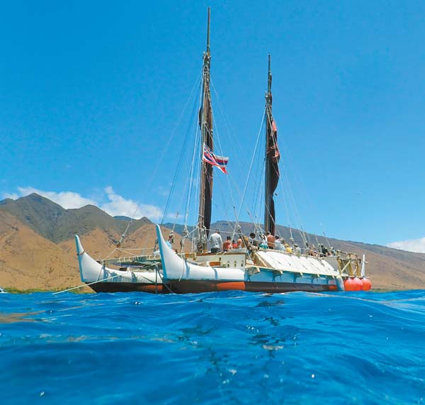 """The Hawaiian voyaging canoe Hokule'a carries crew members and visitors as it anchors in the waters of Olowalu on Thursday morning to celebrate the designation of the reef there as a """"Mission Blue Hope Spot."""" The Maui News / MATTHEW THAYER photo"""
