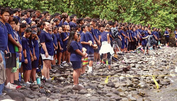 Kamehameha Schools Maui students look out to Hokule'a, some blowing conch shells, during a ceremony Friday to welcome the voyaging canoe to Honolua Bay. The famed voyaging canoe arrived Thursday afternoon in the bay, where the canoe's first trans-Pacific voyage began 41 years ago. The Maui News / CHRIS SUGIDONO photo