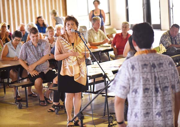 Maui County Council Member Stacy Crivello, who holds the Molokai residency seat, asks U.S. Sen. Brian Schatz for help with her island's transportation woes during a town hall meeting Tuesday in Kahului. The Maui News / MATTHEW THAYER photo