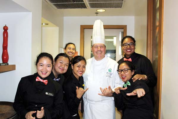 Chef Lecturer Tom Lelli (center) pleased as pie, gives a shaka with students last semester. The Maui News / CARLA TRACY photo
