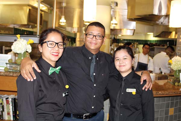 University of Hawaii Maui College Culinary Arts students Jessie Olpindo, (left) and Danielle Soriano flank their Dining Room Lecturer Mark Malone in The Leis Family Class Act. The Maui News / CARLA TRACY photo