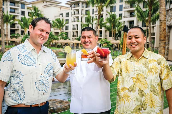 Toasting to the new In The Spirit series is the Westin Nanea Ocean Villas culinary team of Matt Hancock,  the resort's Restaurants and Bars Manager (from left); Ikaika Manaku, executive chef; and Ricky Hamasaki, the assistant director of Food & Beverage. Blinnk Photography images