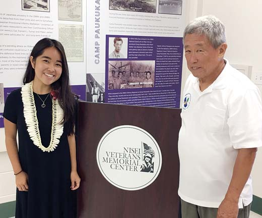 Scholarship recipient Layce Yamauchi (left) and Warren Yamamoto, president of the 100th Infantry Battalion Legacy Organization, are shown at the award ceremony.
