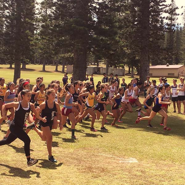 Runners in the girls race take off from the starting line during Saturday's Maui Interscholastic League cross country race on Lanai. -- ROD SUMAGIT photo