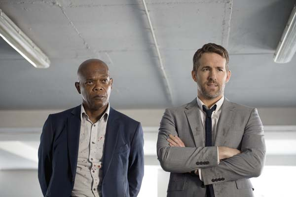 "Samuel L. Jackson (left), and Ryan Reynolds star in ""The Hitman's Bodyguard."" Lionsgate via AP photo"