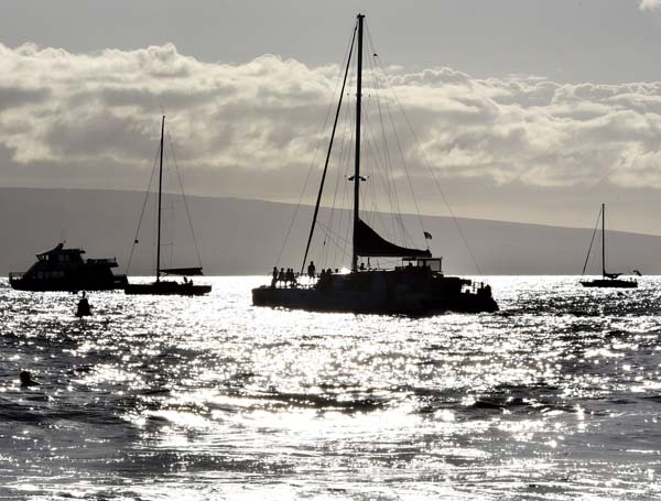 The Trilogy VI sails under an afternoon sun Thursday afternoon off of Lahaina Harbor. Visitor arrivals to Maui increased 2.6 percent to 261,964 in July, compared with the same month last year. The Maui News / MATTHEW THAYER photo