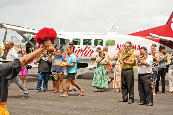Mayor Alan Arakawa (right) and state Sen. J. Kalani English were part of the festivities marking the first Mokulele Airlines flight into Hana Airport on Oct. 1, 2012, as part of a partnership with Travaasa Hana. On Aug. 22, the airline issued a notice with the U.S. Transportation Department that it plans to end nonsubsidized flights to Hana in 90 days in an effort to get the ball rolling on obtaining federal subsidies for the flights. -- The Maui News / MATTHEW THAYER photo