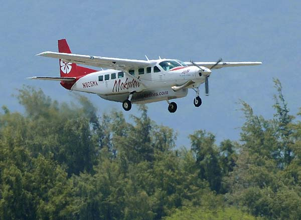A Mokulele Airlines Cessna Grand Caravan is seen taking off from Kahului Airport in April 2014. The airline is seeking government subsidies for service to Hana Airport. -- The Maui News / MATTHEW THAYER photo