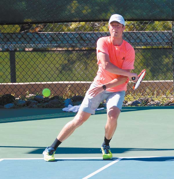 C.J. Bohnen follows through on a shot on the way to defeating Gerald Coons 6-3, 7-6 (5) for the men's open title. The Maui News / BRAD SHERMAN photo
