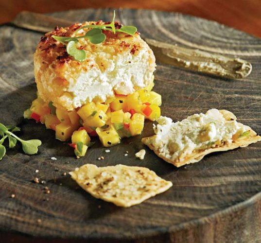 Tommy Bahama in The Shops at Wailea boasts fun appetizers such as mac-nut, goat cheese and mango salsa on  flatbread in the No Kid Hungry promo through September. Tommy Bahama photo