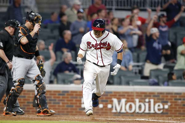 Kurt Suzuki heads out of the batter's box after connecting for a single in the ninth inning that gave the Atlanta Braves a 6-5 win over the Miami Marlins on Thursday. AP photo