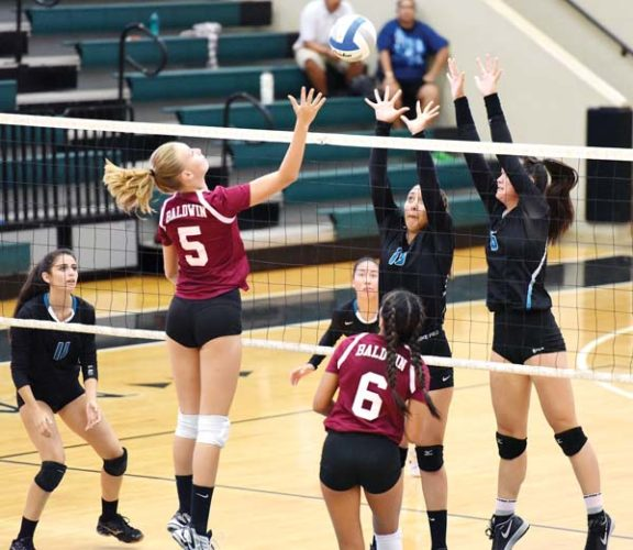 Baldwin High School's Anela Bechert tries to send a shot past King Kekaulike's Nina Macphetridge (right) and Annika Stammberger during the first set of Na Alii's 25-19, 25-9, 25-21 win Thursday. The Maui News / MATTHEW THAYER photo