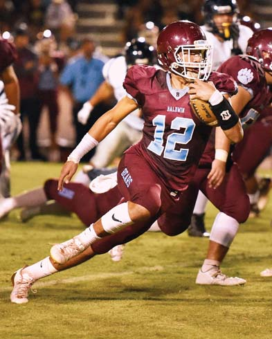 Chayce Akaka carries the ball for Baldwin High School during the first quarter of the Bears' 46-14 win over Kamehameha Maui on Friday at War Memorial Stadium. -- The Maui News / MATTHEW THAYER photo