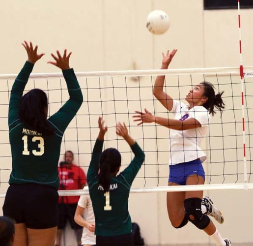 Erica Pilotin of Seabury Hall goes up for a shot as Molo­kai's Sehja Pedro (left) and Mary Grace Ringor defend during the third set of the Spartans' 25-21, 25-19, 25-19 victory over the Farmers on Friday at Erdman Athletic Center. -- The Maui News / CHRIS SUGIDONO photo