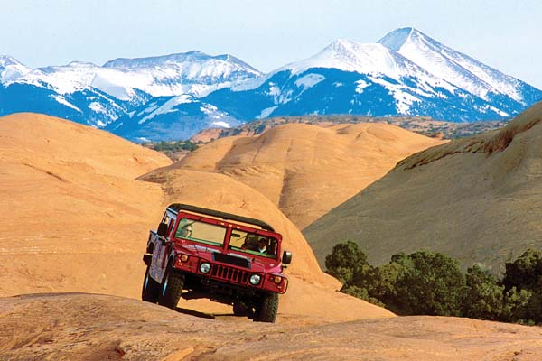 of driving a Hummer past mesas and buttes -- Moab Adventure Center photo