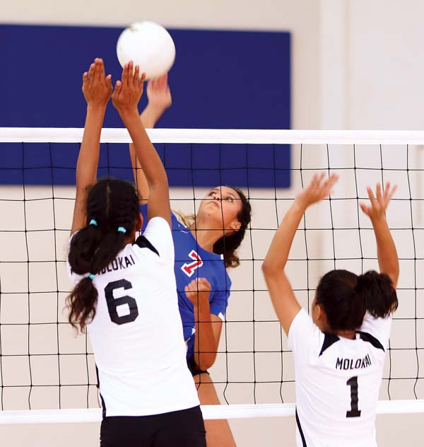 Seabury Hall's Isabel Bennett tries to get a shot past Molokai's Saije Aiana (left) and Mary Grace Ringor during the second set of the Spartans' 25-9, 25-9, 25-12 victory over the Farmers on Saturday at Erdman Athletic Center. -- The Maui News / CHRIS SUGIDONO photo