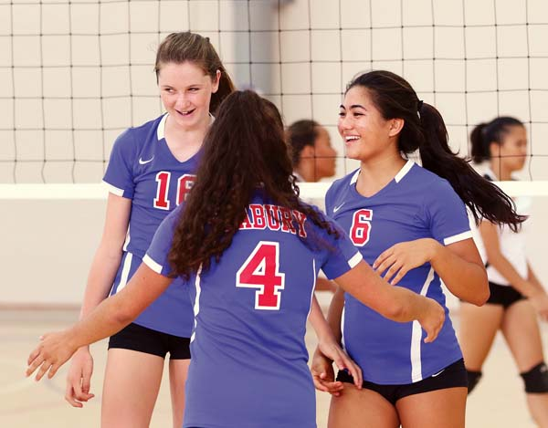 Connor celebrates a point with teammates Kiana Hyman (right) and Abby Drood in the third set. -- The Maui News / CHRIS SUGIDONO photo