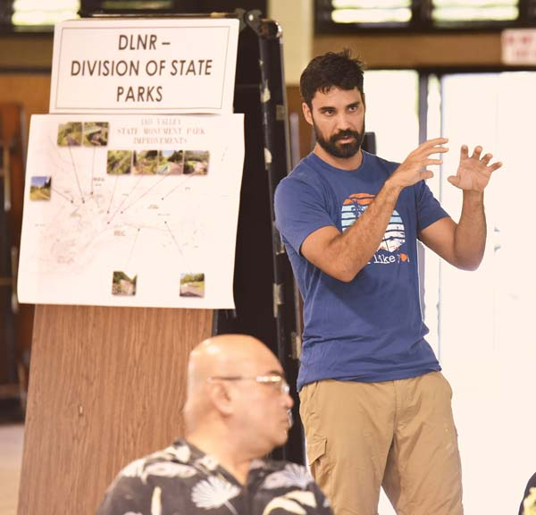 Lifetime Iao Valley resident Kainoa Horcajo poses a question during Tuesday's meeting at the Velma McWayne Santos Community Center on the next step for repairs at Iao Valley State Monument. The Maui News / MATTHEW THAYER photo