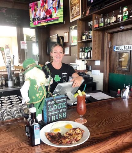 Mulligans on the Blue bartender Bridget Cornell serves Bloody Marys and fresh corned beef and hash for breakfast in the expansive, open-air restaurant in Wailea with 14 flat screens for optimum viewing. Mulligans on the Blue photo