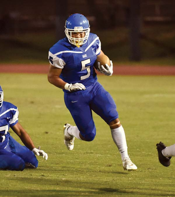 The Sabers' Naia Nakamoto runs for a second-quarter touchdown. -- The Maui News / MATTHEW THAYER photo