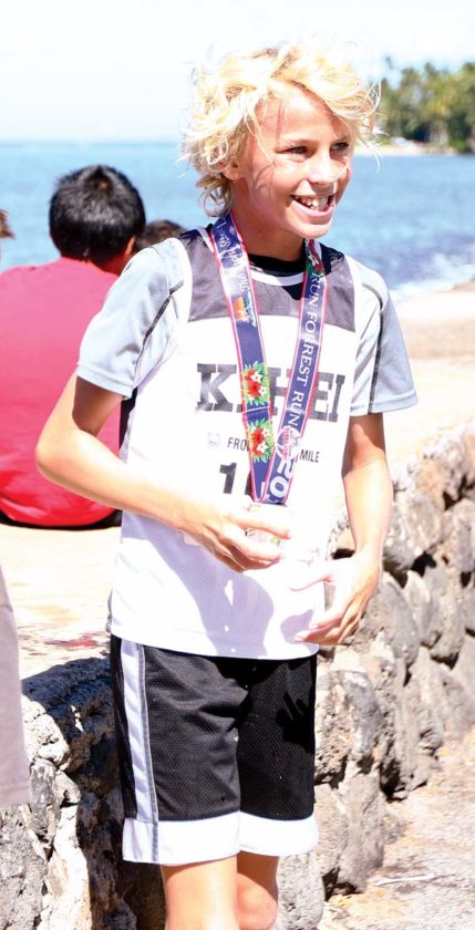 Enzo Queirolo wears his medal after taking first place in the boys 11-12 race in 5:42. -- The Maui News / CHRIS SUGIDONO photo