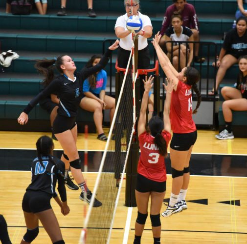 Nina Macphetridge of King Kekaulike High School tips the ball as Lahainaluna's Alana Koa (right) and Aulani Casco-DeLeon defend during the second set of Na Alii's three-set win over the Lunas on Tuesday night at Na Alii's gym. • The Maui News / MATTHEW THAYER photo