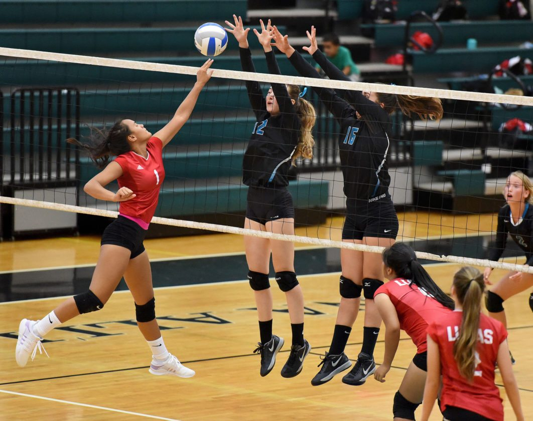 Lahainaluna's Taylor Ganer tries to tip a first-set ball past the block of King Kekaulike's Daniella Wittenberg and Annika Stammberger on Tuesday. • The Maui News / MATTHEW THAYER photo