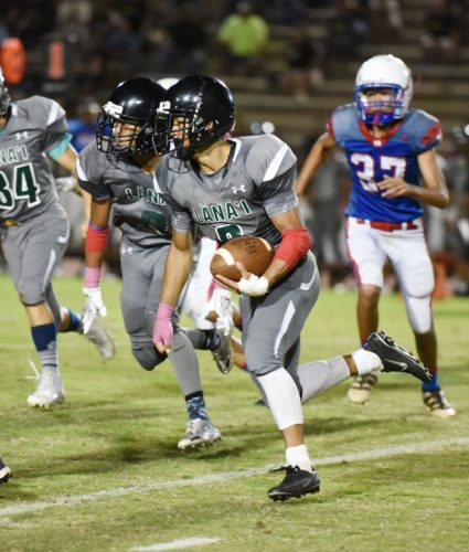 Lanai High School's Naighel Calderon carries the ball in the fourth quarter of Thursday's 48-34 win over Seabury Hall at War Memorial Stadium. • The Maui News / MATTHEW THAYER photo
