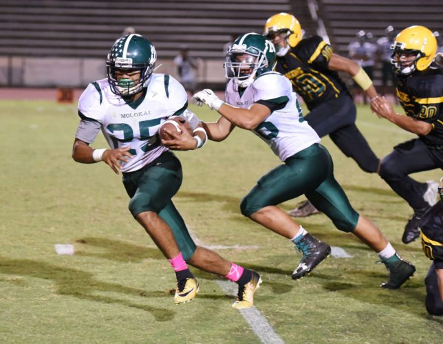 Molokai's Kaimana Nakayama returns a first-quarter fumble against Hana Thursday.