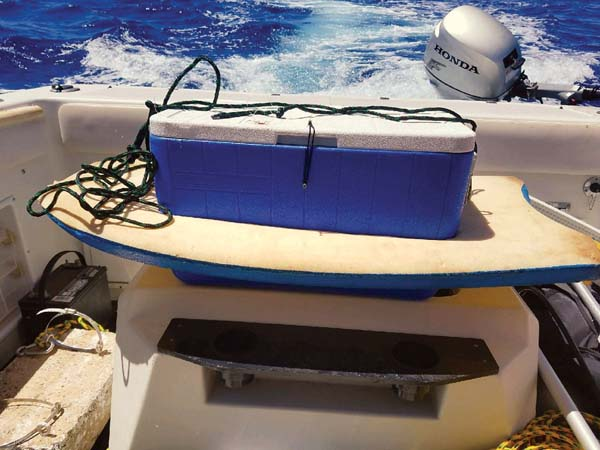 A blue-and-yellow bodyboard with an attached blue cooler was found adrift about 6 miles off of Olowalu Beach on Friday. The U.S. Coast Guard is seeking information on the owner of the equipment. -- U.S. Coast Guard photo