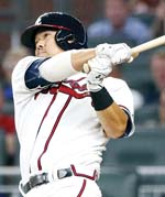 Kurt Suzuki of the Braves follows through on a home run in the first inning of Atlanta's 7-2 win over the Philadelphia Phillies on Friday. -- AP photo